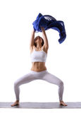Woman doing yoga with blue cloth in air isolated Royalty Free Stock Images