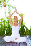 Woman doing yoga breathing exercises Stock Photos