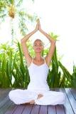 Woman doing yoga breathing exercises Stock Photos
