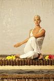 Woman doing yoga exercise Royalty Free Stock Photos