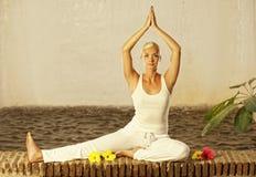 Woman doing yoga exercise Stock Photo