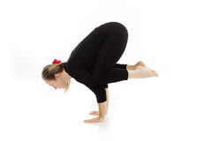 Woman doing yoga exercise. On white background Stock Photos