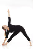 Woman doing yoga exercise. On white background Stock Photo