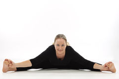 Woman doing yoga exercise. On white background Stock Images