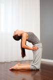 Woman doing yoga exercise Royalty Free Stock Photo