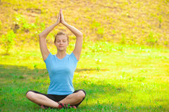 Woman doing yoga exercise Stock Photography