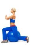Woman doing yoga exercise on the ball Stock Photography