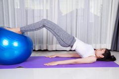 Woman doing yoga exercise with fitness ball Royalty Free Stock Photography