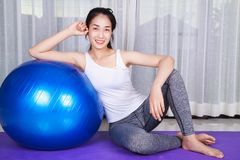 Woman doing yoga exercise with fitness ball Royalty Free Stock Photo