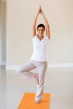 Woman doing yoga exercise Stock Images