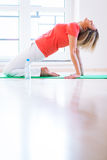 Woman doing YOGA exercise at home Royalty Free Stock Image