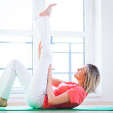 Woman doing YOGA exercise at home Stock Images