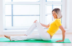 Woman doing YOGA exercise at home Royalty Free Stock Images