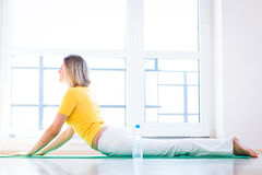 Woman doing YOGA exercise at home Stock Photo