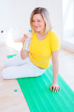 Woman doing YOGA exercise at home Royalty Free Stock Photography