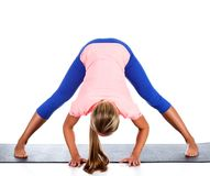Woman doing yoga exercise, isolated on white Stock Photo