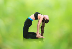 Woman doing yoga exercise with natural blur background Stock Image