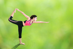 Woman doing yoga exercise with natural blur background Stock Images