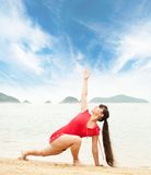 Woman doing yoga exercise outdoors Royalty Free Stock Image