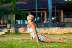 Woman doing yoga exercise outdoors Stock Image