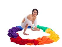 Woman doing yoga exercise - rainbow color ring Stock Photo