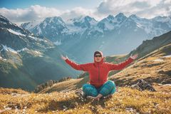 Woman doing yoga exercise on the top of mountain royalty free stock image
