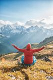 Woman doing yoga exercise on the top of mountain stock images