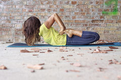 Woman doing yoga exercise Royalty Free Stock Images