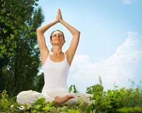 Woman doing yoga exercise royalty free stock image