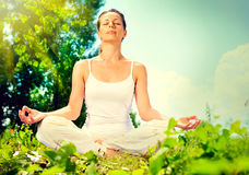 Woman doing yoga exercise. Young woman doing yoga exercise outdoor Royalty Free Stock Image
