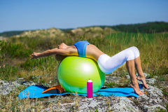 Woman doing yoga exercises on the ball Royalty Free Stock Photo
