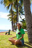 Woman doing yoga exercises on the beach Stock Photography