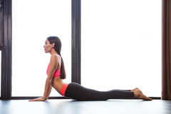 Woman doing yoga exercises in fitness gym Stock Photo