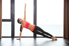 Woman doing yoga exercises in fitness gym Stock Image