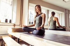 Woman Doing Yoga Exercises In Gym, Sport Fitness Girl Sitting Lotus Pose stock images