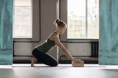 Woman Doing Yoga Exercises In Gym, Sport Fitness Girl Training Stretching royalty free stock photography