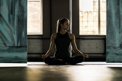 Woman Doing Yoga Exercises In Gym, Sport Fitness Girl Sitting Lotus Pose Stock Image
