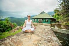 Woman is doing yoga exercises Stock Photo