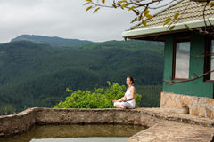 Woman is doing yoga exercises in mountains Stock Photography