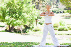 Woman doing yoga exercises outdoors Royalty Free Stock Image