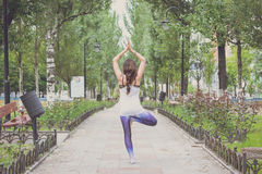 Woman doing yoga exercises outdoors in the city. Stock Photography