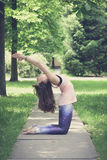 Woman doing yoga exercises outdoors in the city. Royalty Free Stock Images