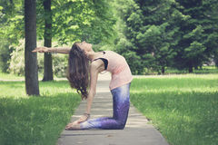 Woman doing yoga exercises outdoors in the city. Royalty Free Stock Photography