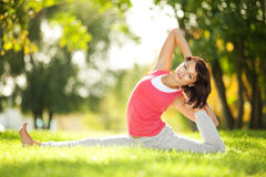 Woman doing yoga exercises in the park Royalty Free Stock Photos