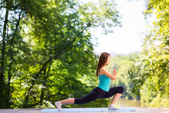 Woman doing yoga exercises. Royalty Free Stock Photography