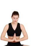 Woman doing yoga with eyes closed Stock Photography