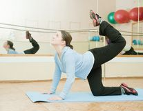 Woman doing yoga in fitness club Stock Image