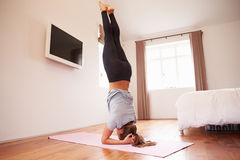 Woman Doing Yoga Fitness Exercises On Mat In Bedroom Royalty Free Stock Images