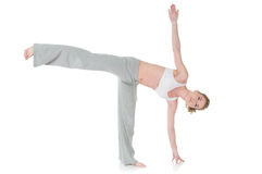 Woman doing yoga, Half Moon/Ardha Chandrasana pose Stock Photo