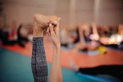 Woman is doing yoga . hand holds feet Stock Image
